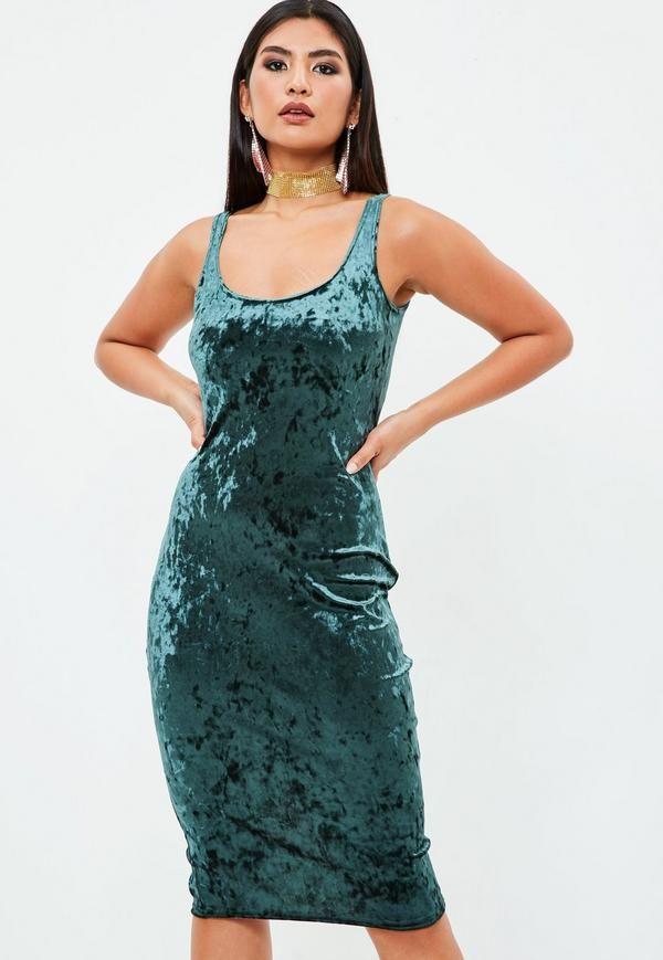 Green velvet midi dress with bodycon design, scoop neck and back slit.