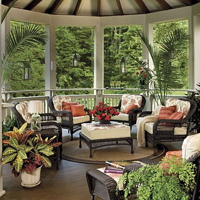 A drink ledge around this circular porch gives you a place to sip your favorite brew. Hanging candle lanterns can be lit during evening outdoor entertaining.