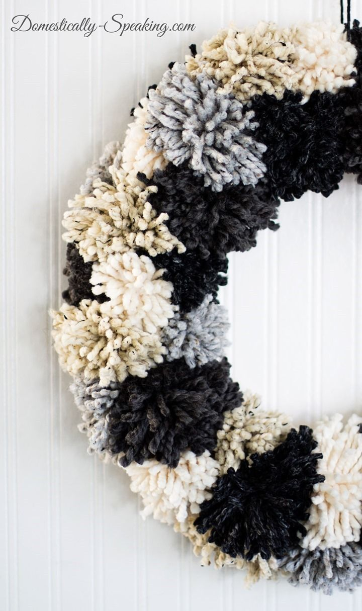 Winter Pom Pom Wreath She's got a great tutorial - looks super easy - anyone could make it! Perfect for your winter decor.
