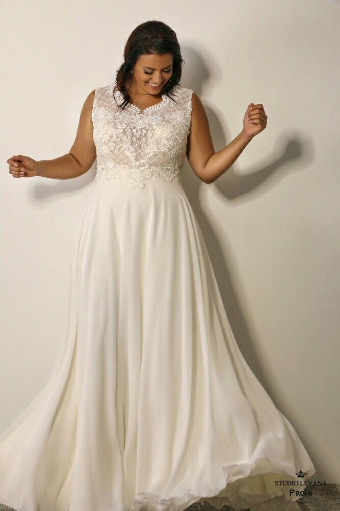 182a5d7c7f14 Beautiful plus size wedding gown with modest cleavage. Paola. Studio Levana