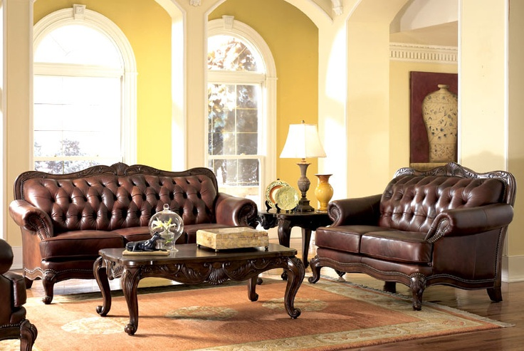 brown leather with terra cotta rug and yellow wallsfor