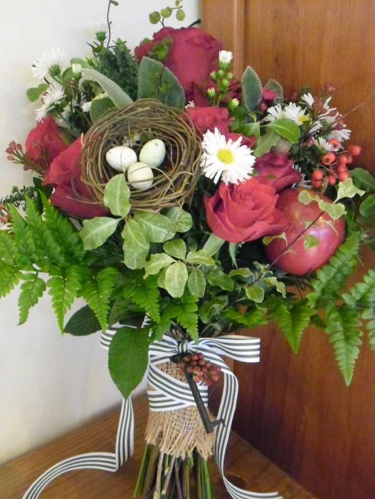 Bouquet of Freedom roses, Michaelmas daisy, pittosporum, leather fern, bud wax, muehlenbeckia, astilbe, cotoneaster, ivy, sage, rosemary, thyme & handmade birdsnest, finished with hessian handle & olive striped grosgrain