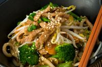 """Chinese Chicken """"Lo-Mein""""  Transform whole-wheat spaghetti noodles into a unique stir-fry. Simply toss chicken with tasty sesame oil and chopped ginger. Boost the antioxidant power by adding broccoli and bok choy, two cancer-fighting superfoods."""