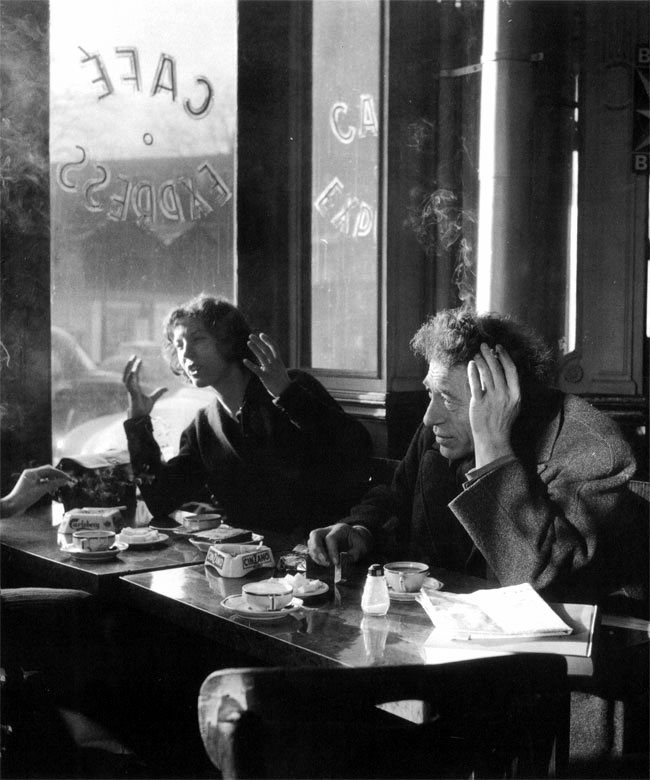 Robert Doisneau // Alberto and Anette Giacometti in Café Express, Paris, 1957.