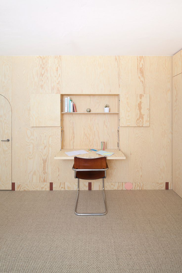 Aurélie Monet Kasisi adds wooden walls with built-in storage to family home in Geneva