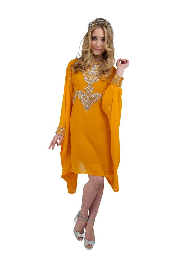 Orange crystal Tunic Dress encrusted with Clear Crystal jewels.  This Stunning Tunic Dress is made from the finest chiffon fabric it has beautiful jewel detail to the front upper and lower neck line finishing with beautiful crystals to the waistband . The style of the dress is extremely flattering as it has a Kaftan style cut which allows it to sit and flow elegantly as worn by our model It is long sheer sleeves with beautiful crystal detail to the cuffs. The dress has an attached inner…