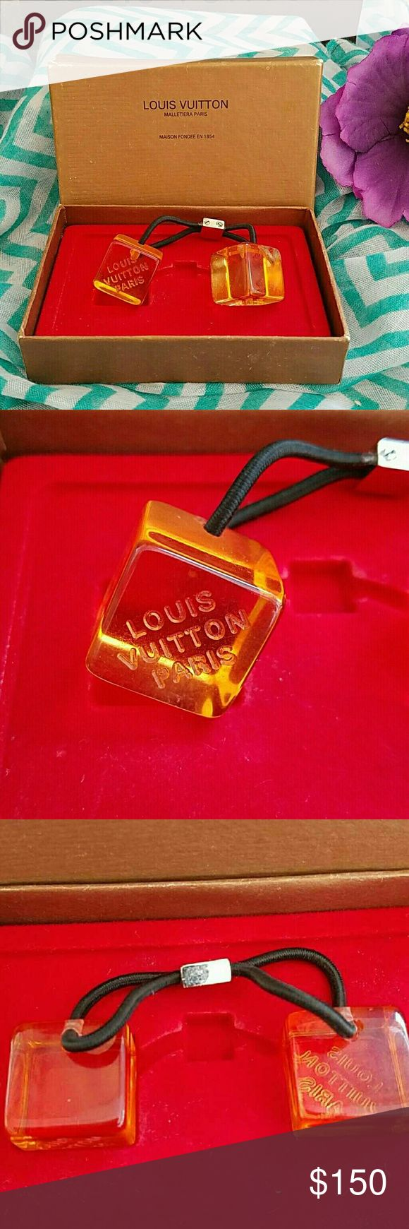 CLEARANCE! RARE! LOUIS VUITTON HAIR CUBES AUTHENTIC VINTAGE LOUIS VUITTON HAIRCUBES AMBER COLOR, PALLADIUM HARDWARE AND SCREWS. ORIGINAL EPI STORAGE BOX INCLUDED BOX HAS SCRATCHES AND SCUFFS, CUBES HAVE SUPERFICIAL SCRATCHES IN GOOD USED VINTAGE CONDITION! FINAL MARKDOWN  75.00 OFF ORIGINAL LISTING PRICE  PRICE FIRM NO OFFERS PLEASE Louis Vuitton Accessories Hair Accessories