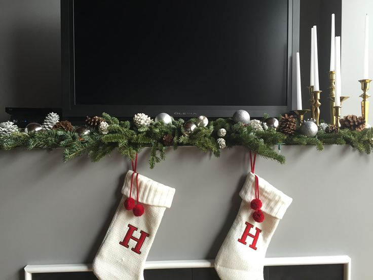 Christmas mantel decorations.  My husband isn't a huge fan of my fireplace mantel decorations as they interfere with his TV operations.  Smile.