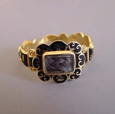 A Victorian-era mourning-ring, again incorporating a lock of the deceased's hair