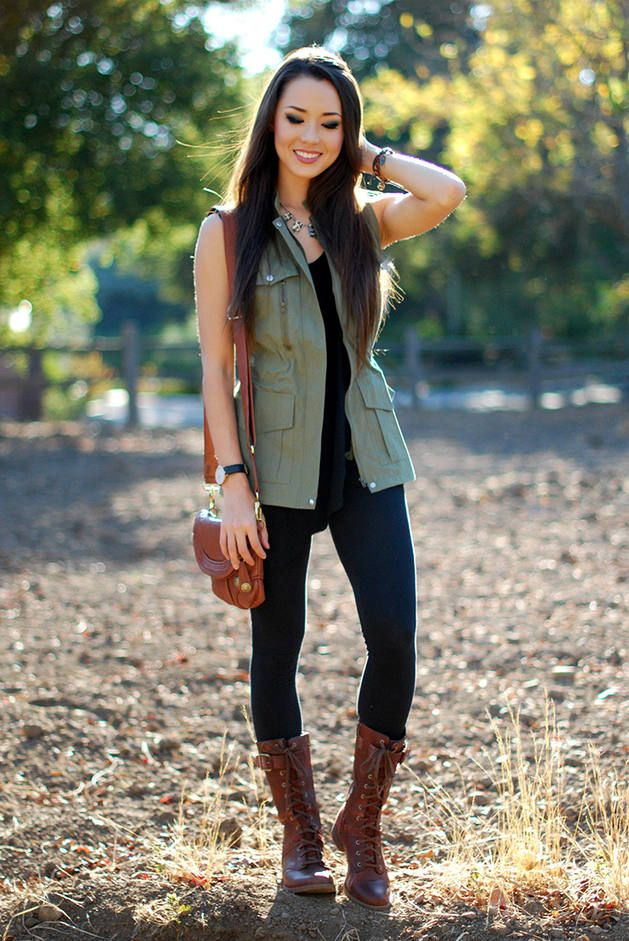 Vests, leggings, mid calf boots and small handbag