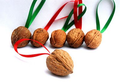 DIY Walnut Jingle Bell Ornament. --jingle bell inside, hot glue shell halves together with ribbon for hanging.