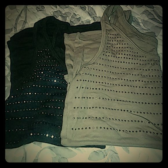 """NY&C tank tops Xlarge These are really cute studded tanks from NY&C. The charcoal has silver studs & the taupe has bronze studs.  60% cotton, 40% modal. Excellent condition. I just don't wear them. Measurements are 36"""" around bust & 19"""" long unstretched. 2nd & 3rd pics are truest colors. New York & Company Tops Tank Tops"""