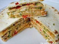la torta di piadine con una farcia di verdure e formaggio!troppo buona perfetta come piatto unico o per un antipasto !!La cucina di ASI