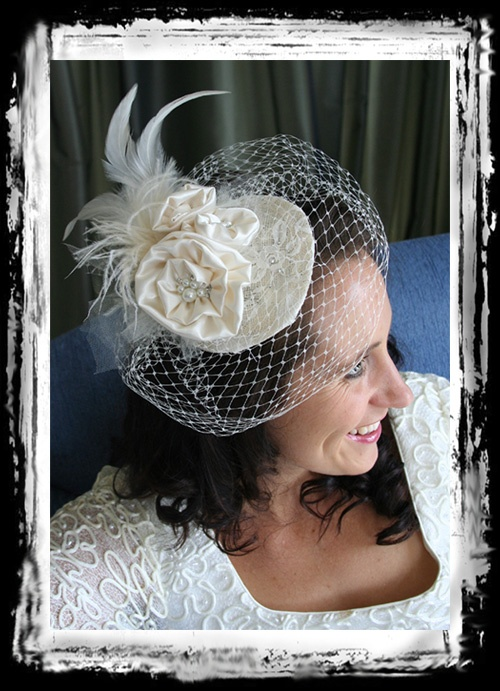 Vintage inspired birdcage with silky cream material, feathers and sparkles. By Margot Ardern Designs