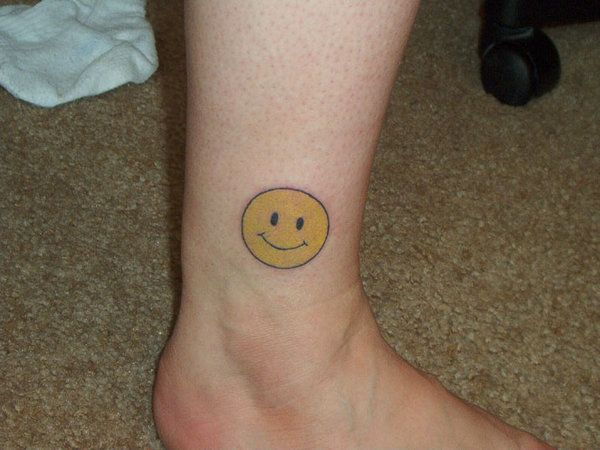 Ten Scary And Silly Smiley Face Tattoo Designs - http://www.2014interiorideas.com/decor-ideas/ten-scary-and-silly-smiley-face-tattoo-designs.html