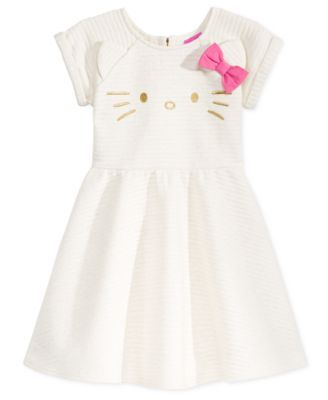 Her favorite Hello Kitty design, complete with ears and bow, peeps out from the lovely textured surface of this jacquard dress. | Polyester/cotton/spandex | Machine washable | Imported | Crew neck | S