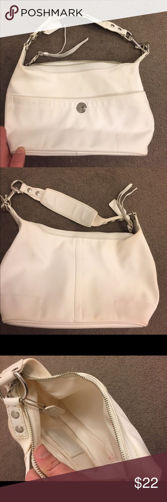 Coach Cream Shoulder Bag Cute and Classic shoulder bag in cream from Coach. It comes with the swing tag, and has a zipper top. There are no major flaws or damage, but there are some staining, marks, and dirty spots as pictured. #coach #cream #purse Coach Bags Shoulder Bags
