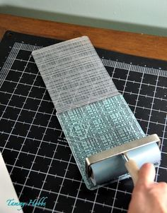 cardmaking tip: use a brayer to evenly ink an embossing folder as for the faux letterpress look ...