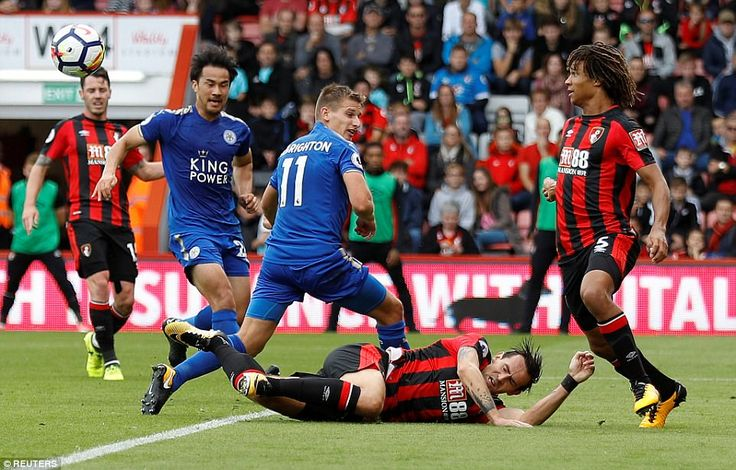 Leicester Marc Albrighton and Shinji Okazaki are stopped by Bournemouth defenders Charlie Daniels and Nathan Ake
