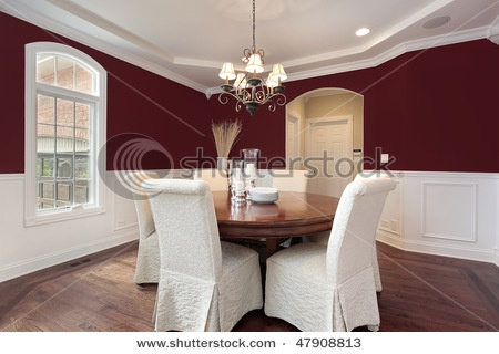 Dark Red Walls With Wainscoting In Dining Room