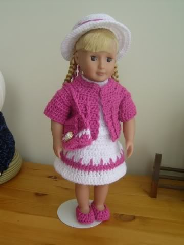 18 in doll outfit (sweater, shirt, skirt, shoes, hat, and purse) - Free crochet pattern.
