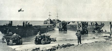 Here's a photograph of two landing craft tank (LCT) used by The Calgary Regiment at Dieppe. These landing craft are undamaged because they remained at sea and did not land during the raid. This photograph was taken on their return to England.
