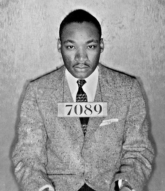 A Montgomery (Ala.) Sheriff's Department booking photo of The Rev. Martin Luther King Jr. taken Feb 22, 1956, with the words ''Dead and the date of 4-4-68'' scrolled on it, is shown Friday, July 23, 2004, in Montgomery, Ala. Dozens of photographs from the civil rights-era were recently discovered in a storage room used by the Montgomery County Sheriff's office. Chief Deputy Derrick Cunningham said he was performing some house cleaning duties when he found a photo-album containing…
