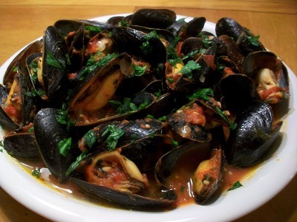 I make Mussels Marinara quite a lot. Even those who claim to not like seafood, can't get enough. I always serve this with plenty of French bread and wine; red and white. -CW-