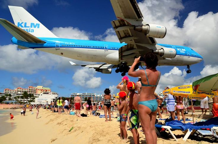 Another one showing how low the planes come into St Maarten. Unbelievable!