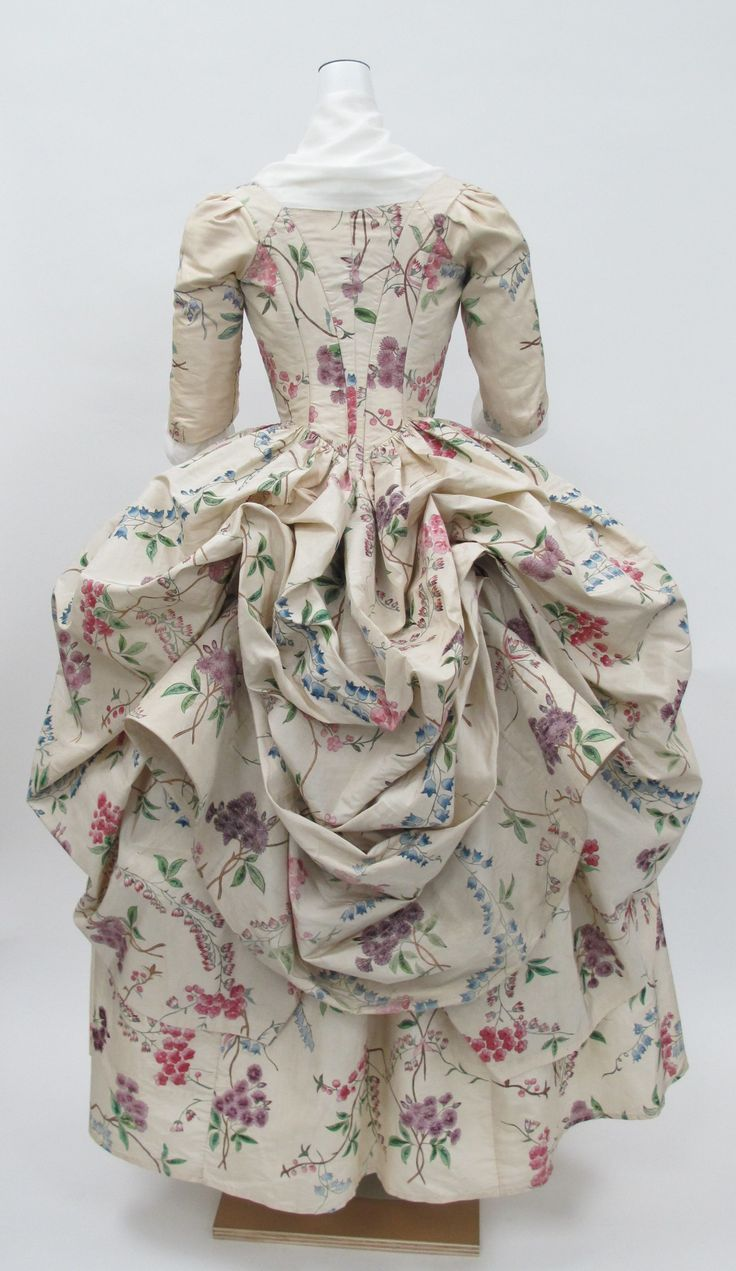 The polonaise gown first came into fashion in the 1770s. It was a style of gown with a close-fitting bodice and the back of the skirt gathered up into three separate puffed sections to reveal the petticoat below
