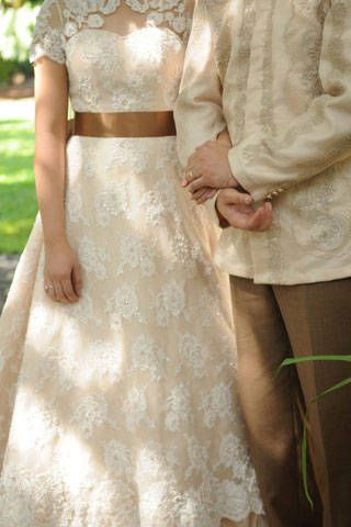 The bride's A-line gown featured a dainty re-embroidered and scalloped alencon lace overlay. The scallops matched the delicate embroidery on the groom's coat barong. | www.BridalBook.ph