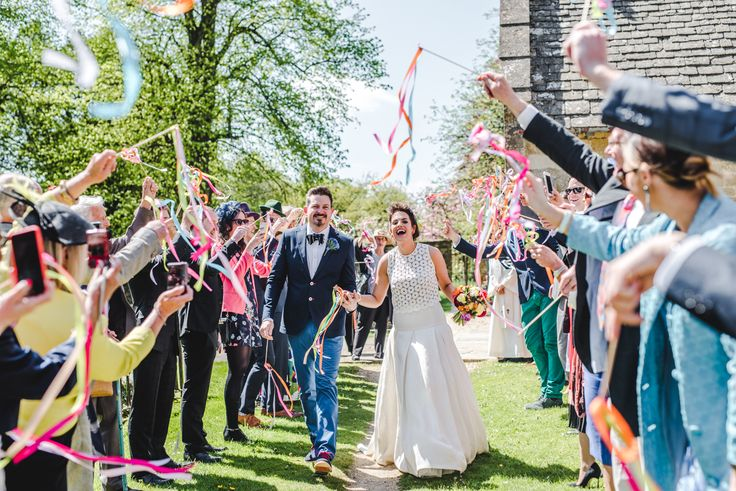 Paper tassels like these make a great alternative to throwing confetti as they won't litter the environment or endanger local wildlife. Image © Big Eye Photography. #wedding #cotswoldwedding #weddinginspiration