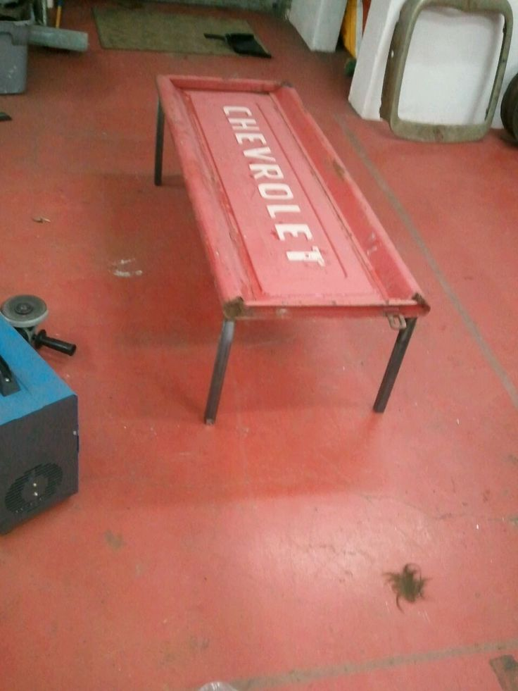 """Used an old tailgate and welded 1""""x1"""" square tube to the backside of it.  Makes a perfect coffee table for a man cave or home!"""