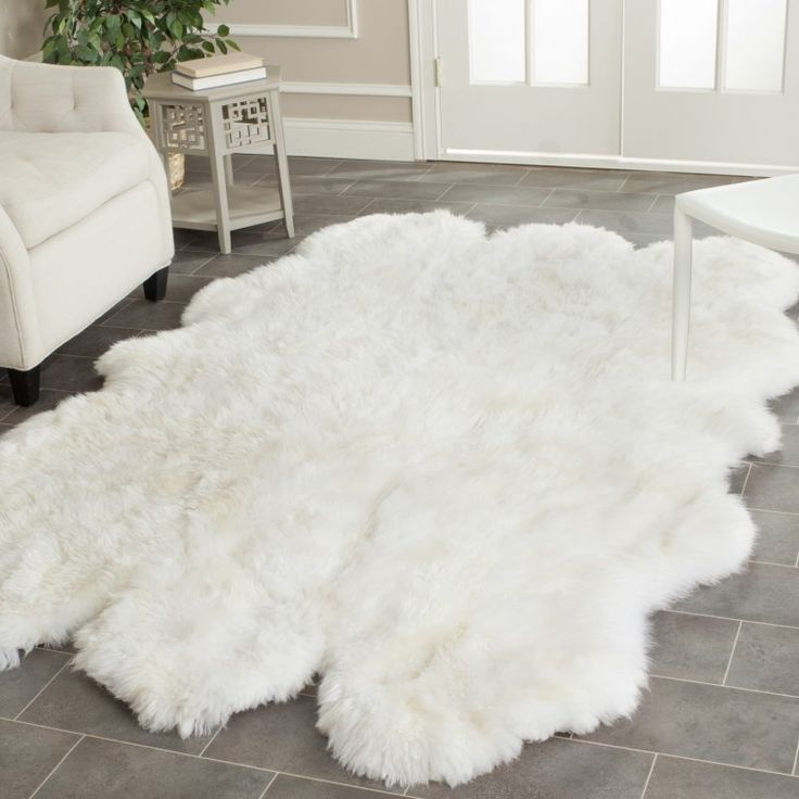 White Faux Sheepskin Rug Plus White Armchair On Grey Ceramic Tiled Floor For Living Room As Well As Faux Animal Skin Rugs Plus Plush Faux Animal Skin Rugs
