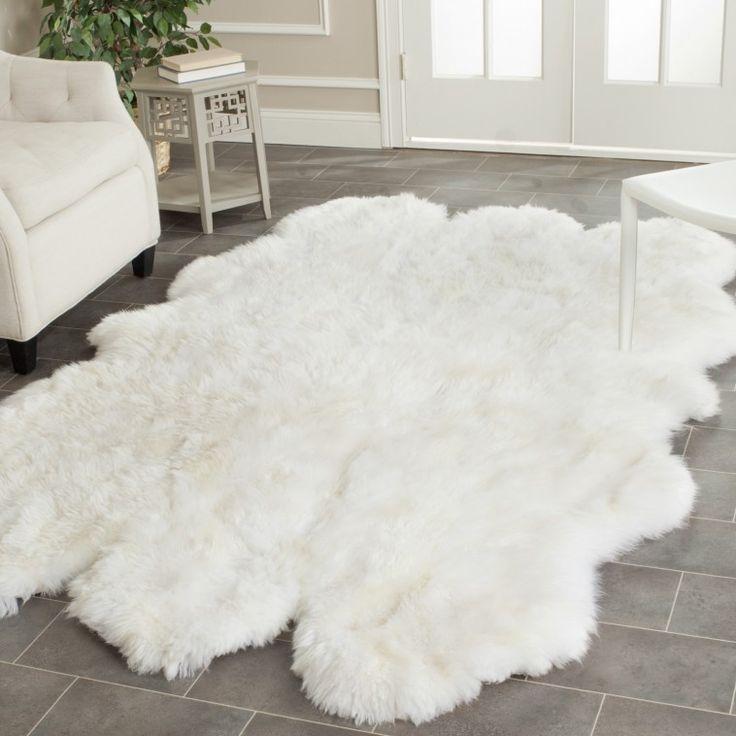 White Faux Sheepskin Rug Plus White Armchair On Grey Ceramic Tiled Floor For Living Room As Well As Faux Animal Skin Rugs Plus Plush Faux Animal Skin Rugs