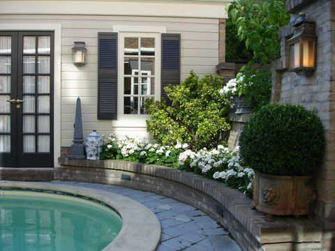 light greige weatherboards, woodland grey ? french doors and shutters, grey pavers