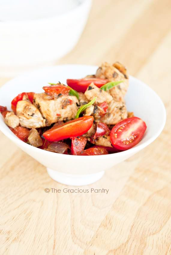 Clean Eating Red Vegetable Chicken Skillet makes a quick and tasty dinner everyone will love! Brought to you by cookbook author, Tiffany McCauley of The Gracious Pantry.com.
