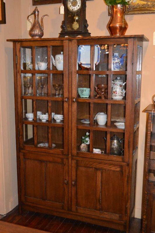 Mission Oak China cabinet / Arts and Crafts Bookcase on Etsy, $1,195.00. I like the style, but the wood bars on the glass doors are too heavy.