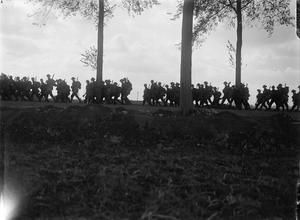 WWI, 5 Sept 1917, Battle of Passchendaele; Relieving Battalion, 4th Battalion, Dorset Regiment, marching up to the line in the evening, on a road near Ypres. ©IWM Q 3003