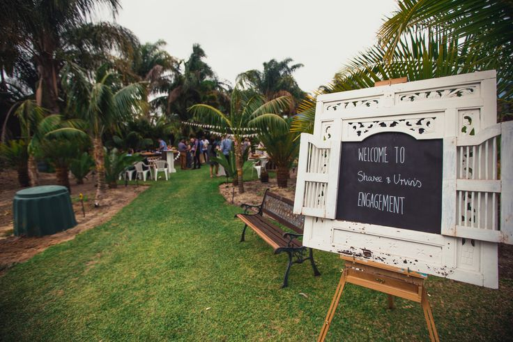 Entrance to the engagement party using chalk board, easel and window frame.