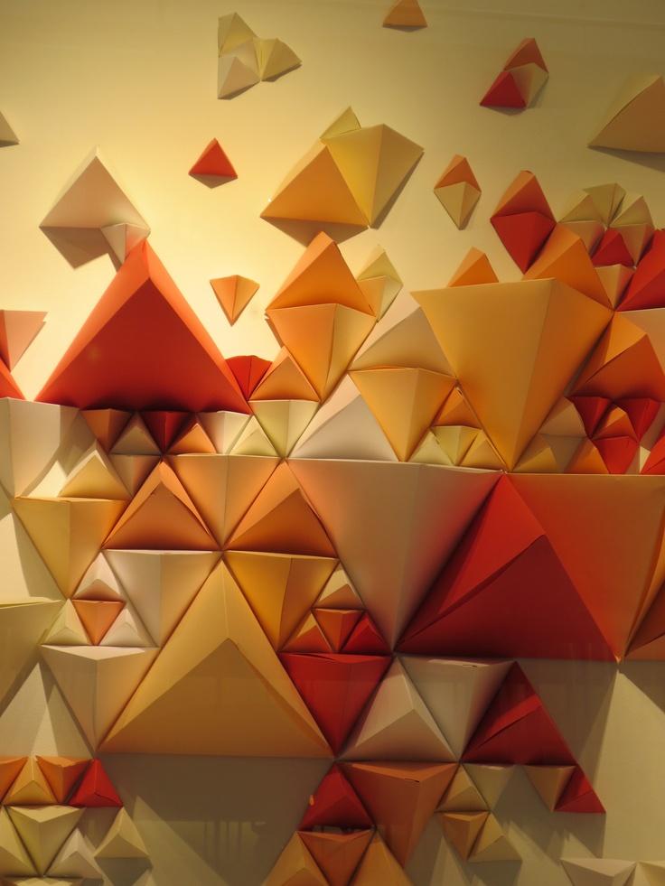 Paper pyramids make a beautiful backdrop in this Club Monaco window display.