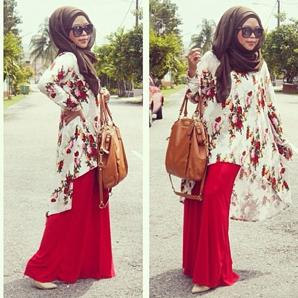 Shea Rasool in a lovely flowered tunic over a long, red maxi skirt