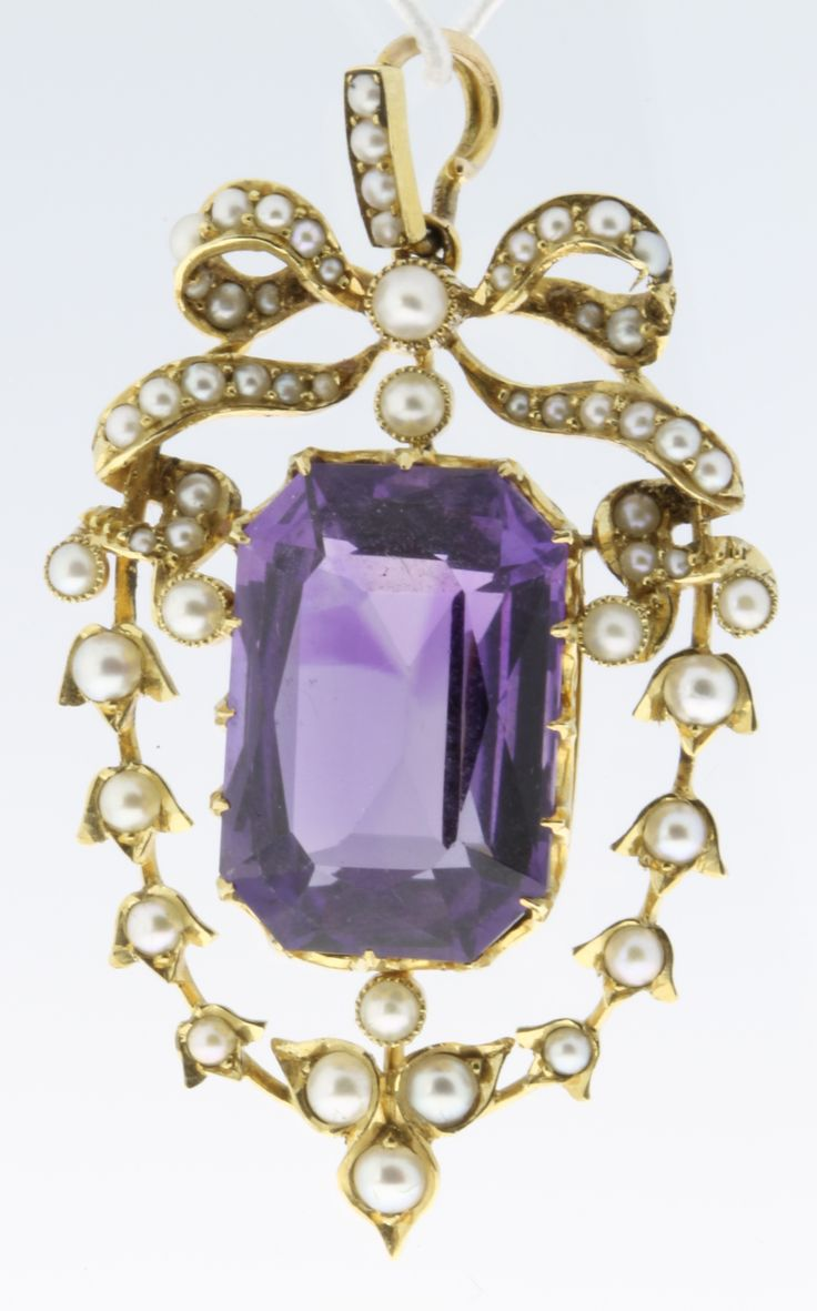 Lot 548, An Edwardian high carat seed pearl and amethyst pendant, est  £180-220