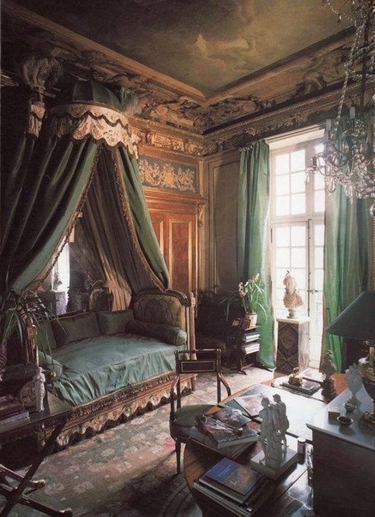old world decor charm is evident in this fabric covered bed space it is
