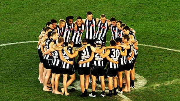 Collingwood players celebrate their win in the 2010 grand final replay.