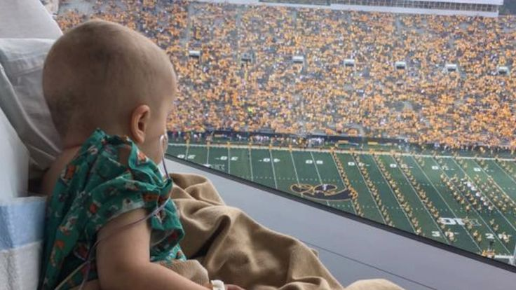 9/16/17: From his hospital bed a 4-year-old smiles as he looks down at the crowd waving at him. Wyatt Hemphill's immune system is so weak, it might as well be non-existent, his family explains. Wyatt is one of many kids at the hospital thrilled with all the fans and players cheering for them in the middle of an Iowa Hawkeyes game. It's a new tradition that just started this month. InsideEdition.com's Leigh Scheps (http://twitter.com/LeighTVReporter) has more.
