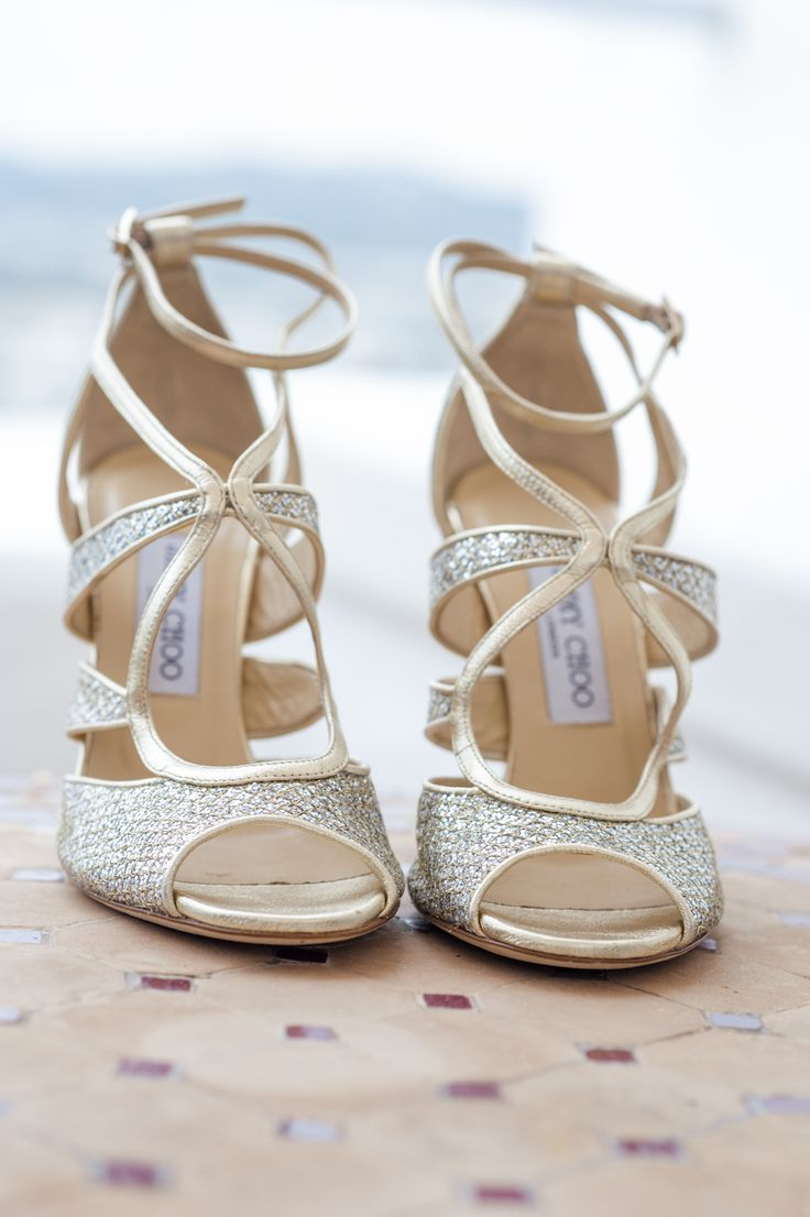 Gold strappy Jimmy Choo sandals - Image by Marnosuite Wedding Photography - Bespoke Gold Lace Gown, With Jimmy Choo Shoes for a Destination Wedding in Ibiza with rustic outdoor ceremony & reception and bright flowers & decor.