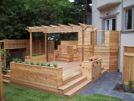 Perfect deck, love the built in planters and pergola overhead!