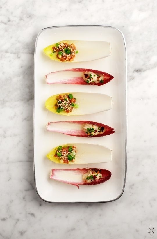 Endive Boats: one with lemony white beans and the other with tuna tartare. | - #recette #dressage #assiette #artculinaire #art #food #foodporn #gastronomy #gastronomic #fooddesign #culinary #foodart #gourmet #gourmand #joiedevivre #museumviews #HauteCuisine