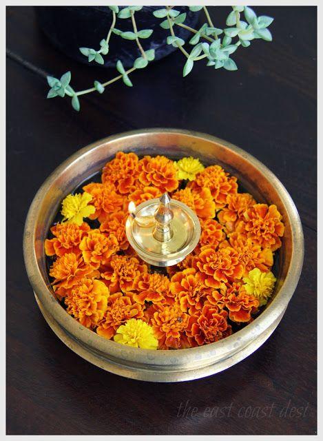 classic arrangement  -Floating flowers in a urli